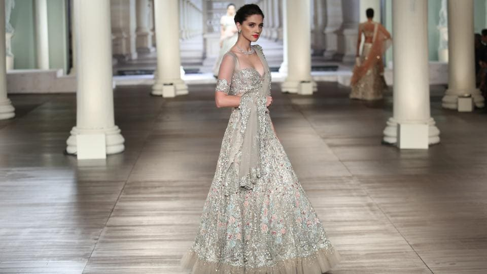 The designers showcased lehengas, anarkalis, sarees and sherwanis in natural, diaphanous fabrics that were both bold and classic. (amal ks/ht photo)