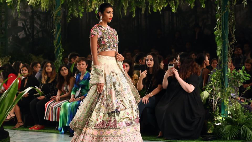 In the second show on Day 4, ffashion designer Rahul Mishra offered a collection of modern-feeling lehengas, floor-grazing anarkalis, sarees and capes inspired by Mughal era architecture and miniature paintings. (jasjeet plaha/ht photo)