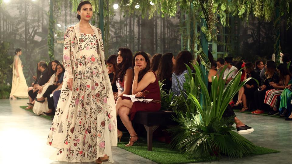 Mishra merged the past with the present in a bevy of unique Mughal era architecture-inspired lehengas, sarees, floor-grazing jackets, anarkalis and capes embellished with dizzying geometric and floral motifs in a spectrum of colours.  (jasjeet plaha/ht photo)