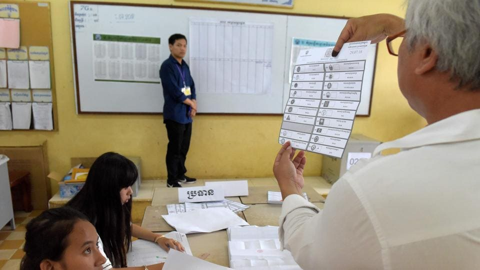 Cambodian election officials count ballots during the general elections at a polling station in Phnom Penh on July 29, 2018.