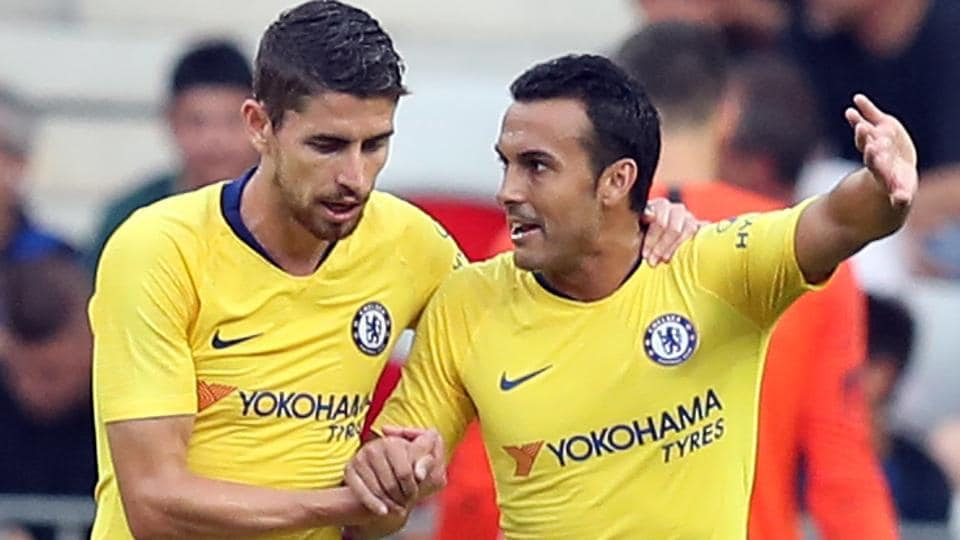 Chelsea's forward Pedro (R) celebrates after scoring a goal against Inter Milan.