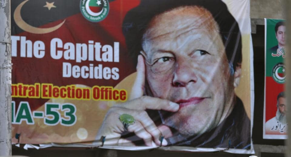 A big poster of Imran Khan, head of Pakistan Tehreek-e-Insaf party, at a market in Islamabad on July 28.