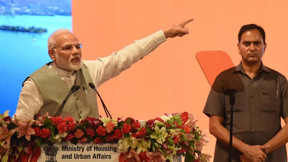 Prime Minister Narendra Modi during a programme to mark completion of three years of Smart City Mission, AMRUT and Pradhan Mantri Avas Yojna, at Indira Gandhi Pratishthan, in Lucknow on July 28.
