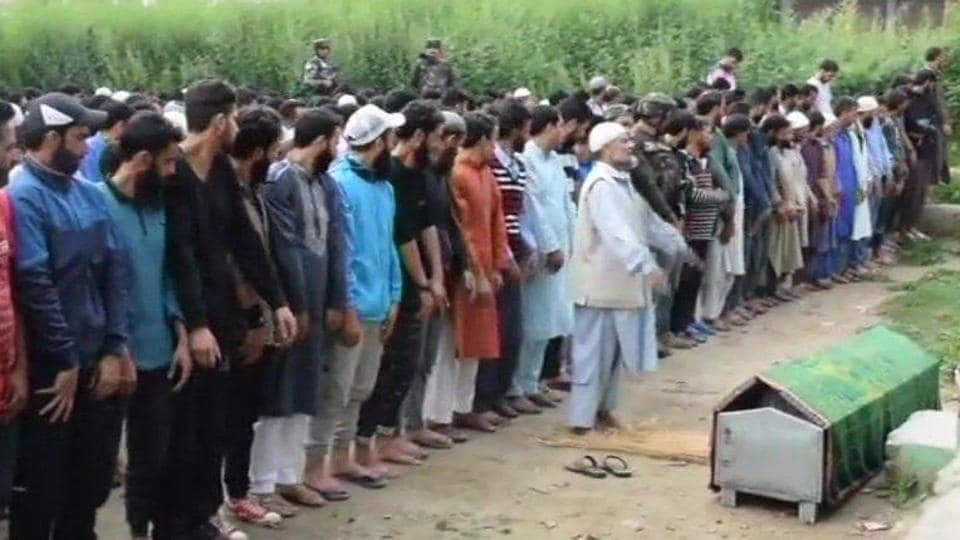 People gather for the last rites of CRPF Jawan Naseer Ahmed, who was shot dead on Sunday, in Pulwama.