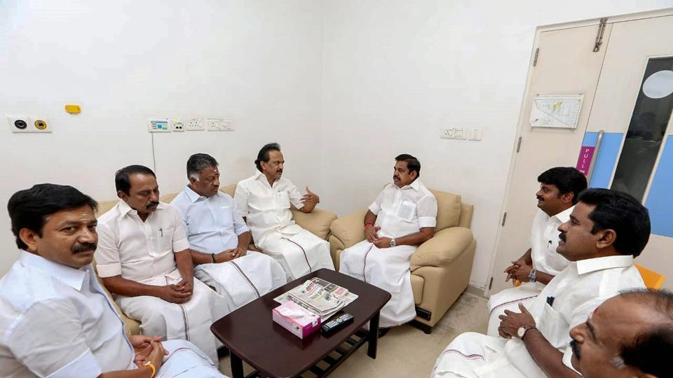 "Tamil Nadu Chief minister Edappadi K Palaniswami, Deputy Chief Minister O Panneerselvam and others meet Dravida Munnetra Kazhagam (DMK) working President MK Stalin to inquire about his father and DMK Chief M Karunanidhi's health at a hospital, in Chennai.  ""I have just met him in Kauvery hospital, he is better and is recovering well,"" Palaniswami said after meeting Karunanidhi. (PTI)"