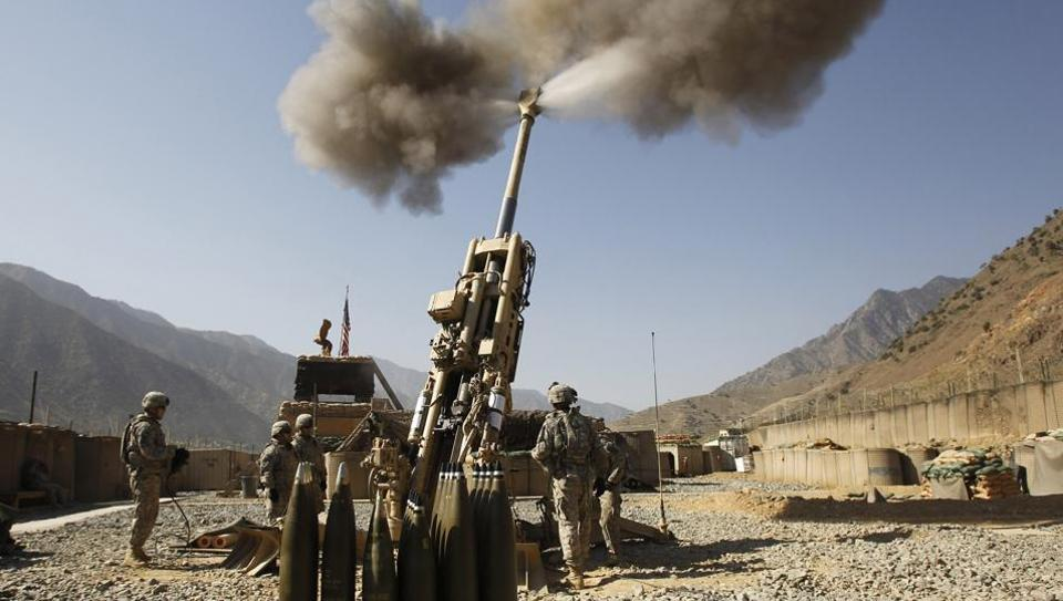 US soldiers from Charlie Battery, 321st Field Artillery Regiment fire a 155MM M777 howitzer at a Taliban enemy position from Forward Operating Base (FOB) Bostic, in Kunar province, eastern Afghanistan September 28, 2011.  India is testing these guns at Pokhran and will acquire 145 Howitzers from the US in the next three years.