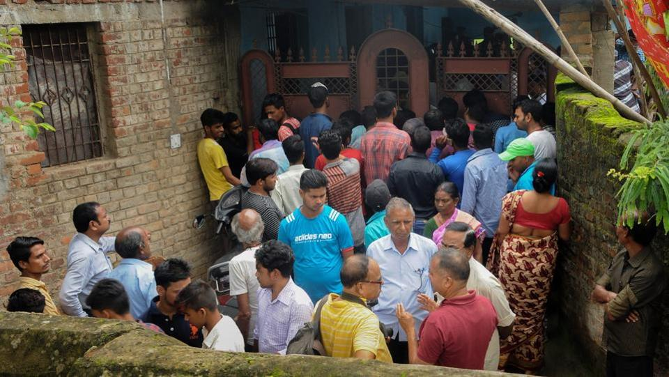 People gather outside the house where seven members of a family allegedly committed suicide, in Ranchi on Monday. Deepak Kumar Jha, working with a leading private company, committed suicide along with his parents, brother, wife and two children, a police officer said. The reason for the suspected suicide is not clear. This is second case of mass deaths in a family in the last 10 days in Jharkhand. (PTI)