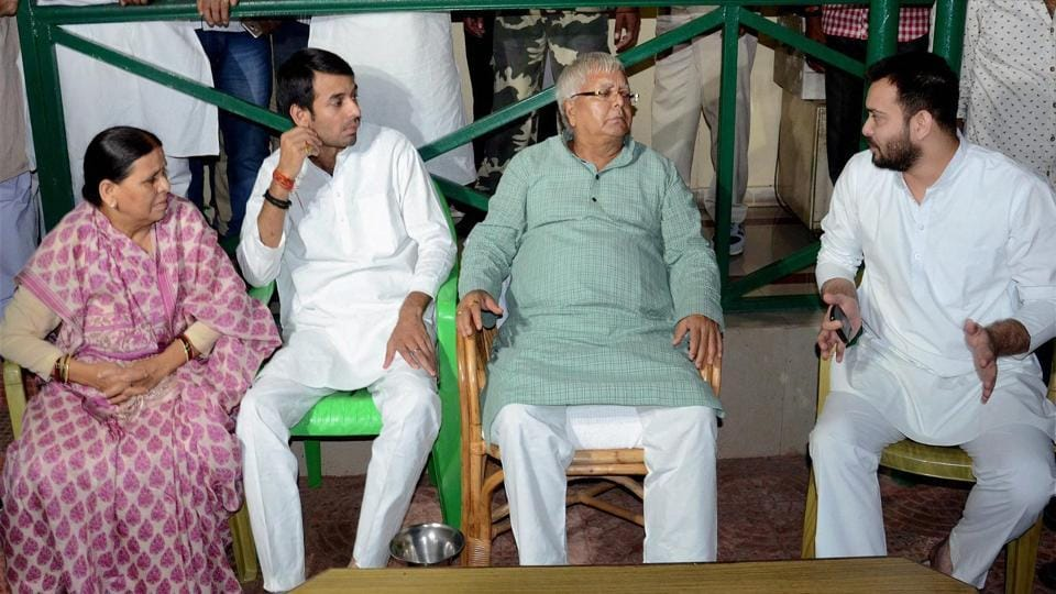 RJD chief Lalu Prasad with wife Rabri Devi and sons Tej Pratap (second left)and Tejashwi Yadav (right)at a party meeting in Patna.