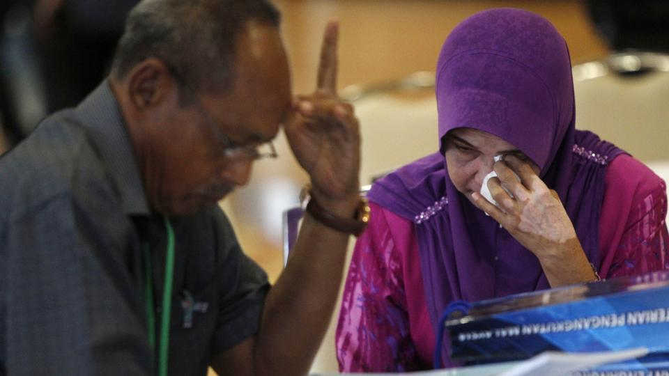 A relative of passengers on board the missing Malaysia Airlines Flight 370 reacts as she arrives for MH370 safety investigation report briefing at ministry of transportation in Putrajaya, Malaysia, July 30, 2018.