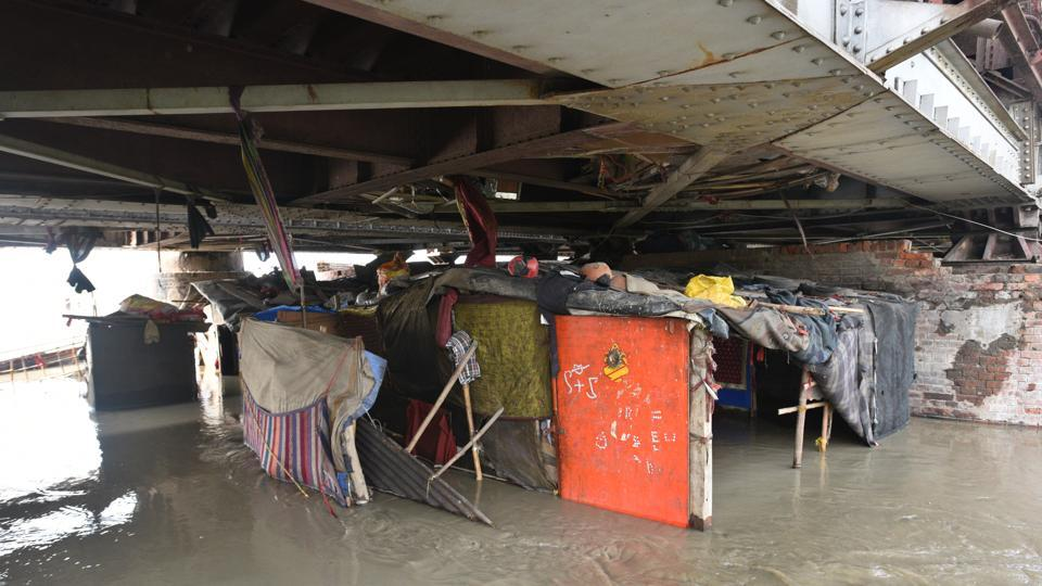 A view of submerged shanties as the water level of Yamuna river continues swelling in Delhi, July 29,  2018. Families who were staying on flood plains have been shifted to tents set up by the government .