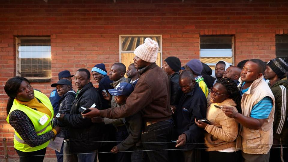 Zimbabwean electoral officials began counting ballots in the first vote of the post-Robert Mugabe era that opinion polls show is too close to call. The front-runners for the presidency are the ruling Zimbabwe African National Union-Patriotic Front's Emmerson Mnangagwa, 75, Mugabe's one-time deputy and successor, and his main rival Nelson Chamisa, 40, a lawyer and church pastor who heads the Movement for Democratic Change. (Alex Mcbridge / AFP)