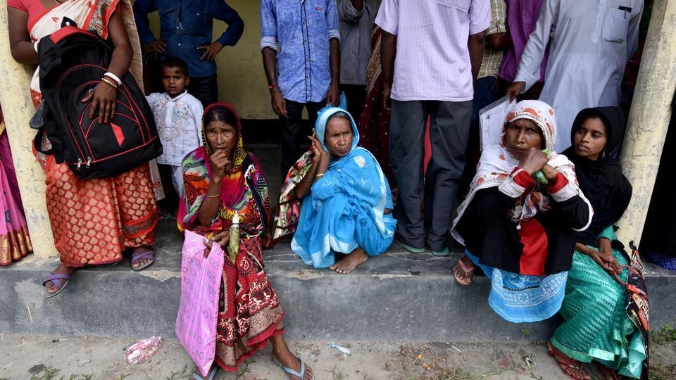 Villagers wait outside the National Register of Citizens (NRC) centre to get their documents verified by government officials, at Mayong Village in Morigaon district, Assam.