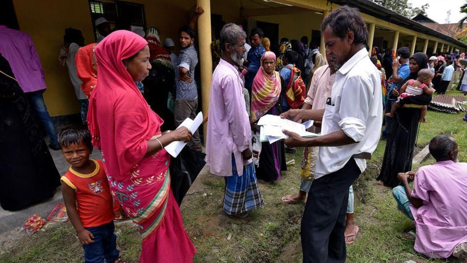 Villagers wait outside the National Register of Citizens (NRC) centre to get their documents verified by government officials, at Mayong Village in Morigaon district, in Assam.