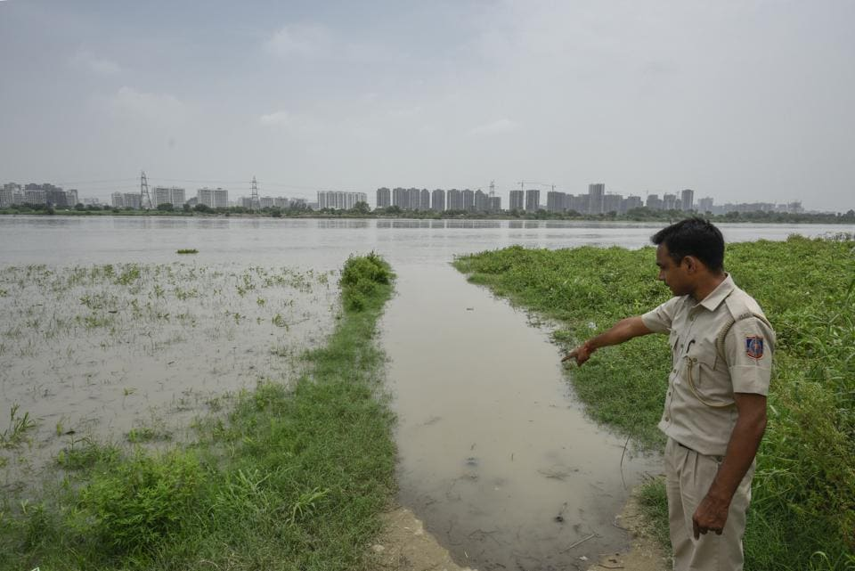 A view of flooded areas near the banks of Yamuna river. The authorities evacuated families who were staying on Yamuna flood plains to makeshift tents set up by the Delhi government, in New Delhi, on July 30, 2018.