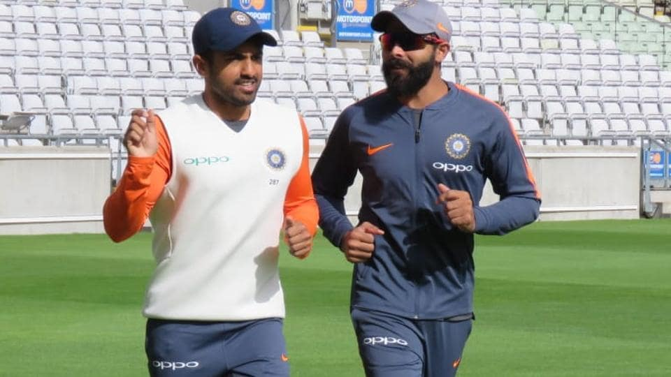 Karun Nair (L) and Ravindra Jadeja chat during the practice session. (BCCI)