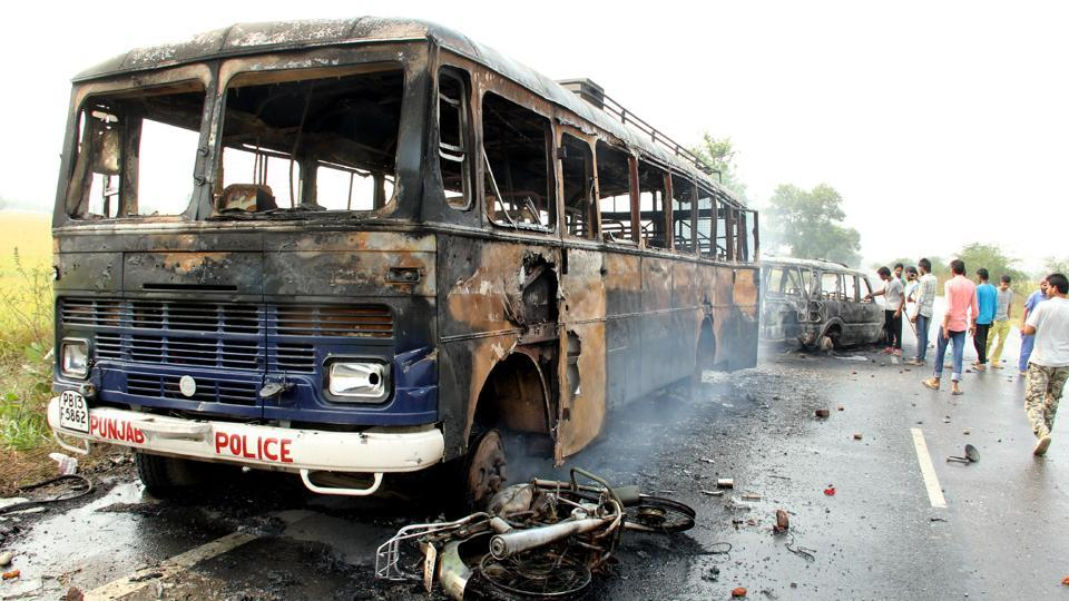 A torched police vehicle during a protest at Behbal Kalan village in Faridkot.
