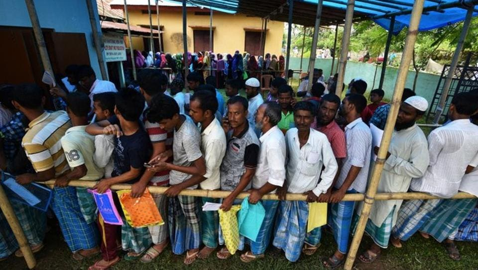 People wait in queue to check their names on the draft list at the National Register of Citizens (NRC) centre at a village in Nagaon district, Assam state, India, July 30, 2018.