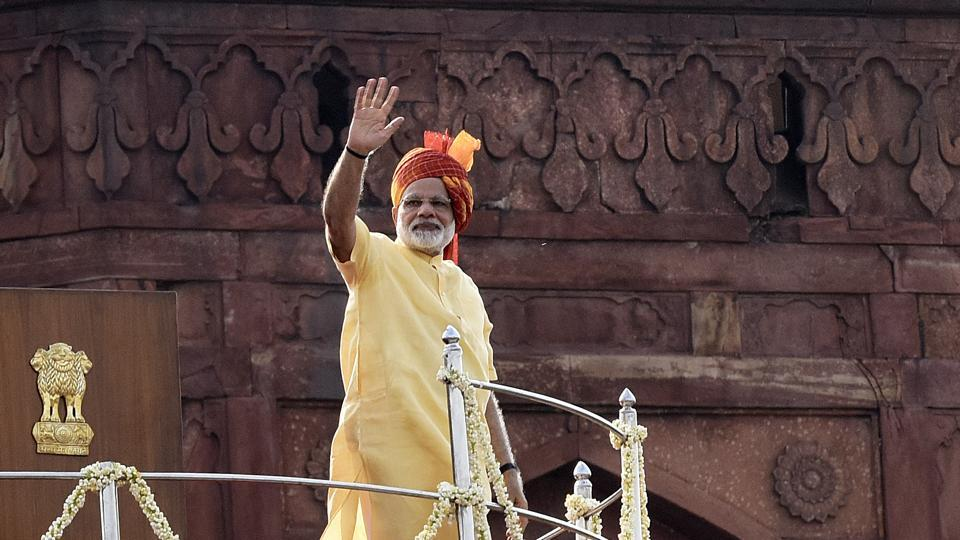 Prime Minister of India Narendra Modi waves before addressing a crowd on Independence Day, at Red fort in New Delhi.