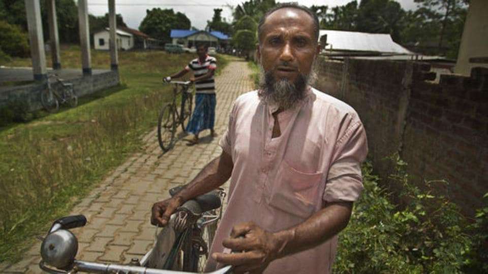 Abdul Manan, a Muslim man returns after finding that his name is not included in the National Register of Citizens draft in Mayoung. (Anupam Nath / AP)