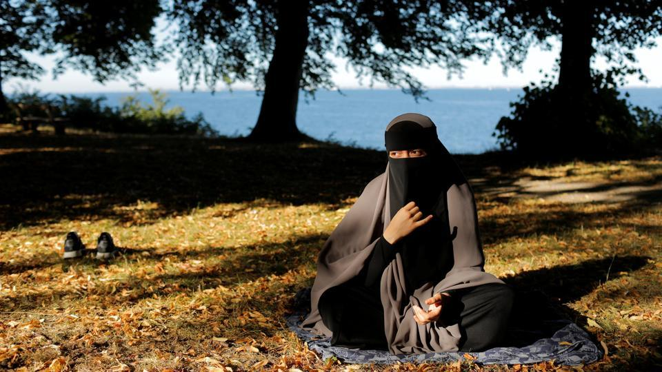"As face veils are banned in Denmark from Wednesday, Sabina, 21, who is studying to be a teacher, has joined other Muslim women to form Kvinder I Dialog (Women In Dialogue) to protest and raise awareness about why women should be allowed to express their identity. ""I won't take my niqab off. If I must take it off I want to do it because it is a reflection of my own choice,"" Sabina said. (Andrew Kelly / Reuters)"