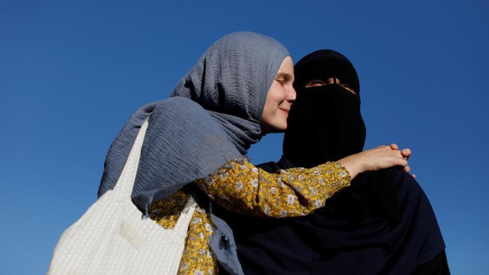 Natacha (L), 21, and Nayab, 18, both members of the group Kvinder I Dialog stand together on a playground. The niqab wearers who plan to protest will also be joined by non niqab wearing Muslim women and also non-Muslim Danes, most of whom plan to wear face coverings at the rally. (Andrew Kelly / Reuters)