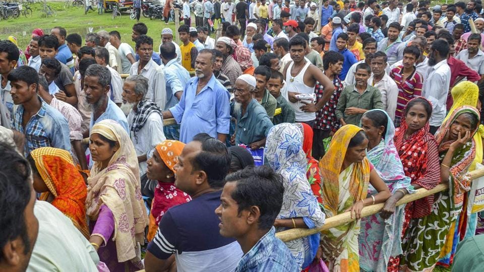 "People wait to check their names on the final draft in Tezpur. Registrar General of India Sailesh, who released the draft, said ""ample opportunity"" would be given to these applicants if they file claims and objections between August 30 and September 28 before the final list is prepared. (PTI)"