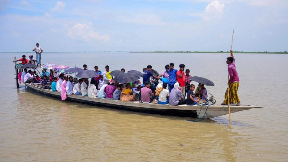 Villagers arrive by boat to check their names in the final draft of the National Register of Citizens  at a centre at Goroimari after its release, in Kamrup district of Assam on Monday, July 30