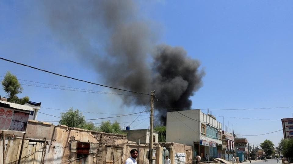Smoke rises from an area where explosions and gunshots were heard, in Jalalabad city, Afghanistan, on Tuesday.