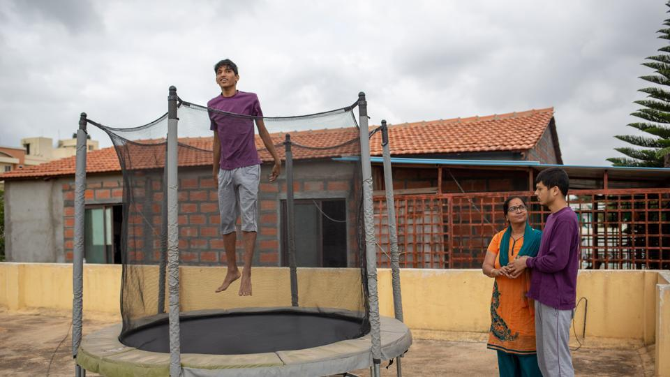 A specially abled person on a trampoline at ALFAA (Assisted Living for Autistic Adults), in Bengaluru. Ruby Singh, the mother of an autistic man, runs the ALFAA trust and daycare centre which cares for 22 specially abled people aged 14 to 29, with the help of 14 special educators and caretakers. In five years, Ruby hopes to have a residential facility up and running too. (Vivek M / HT Photo)