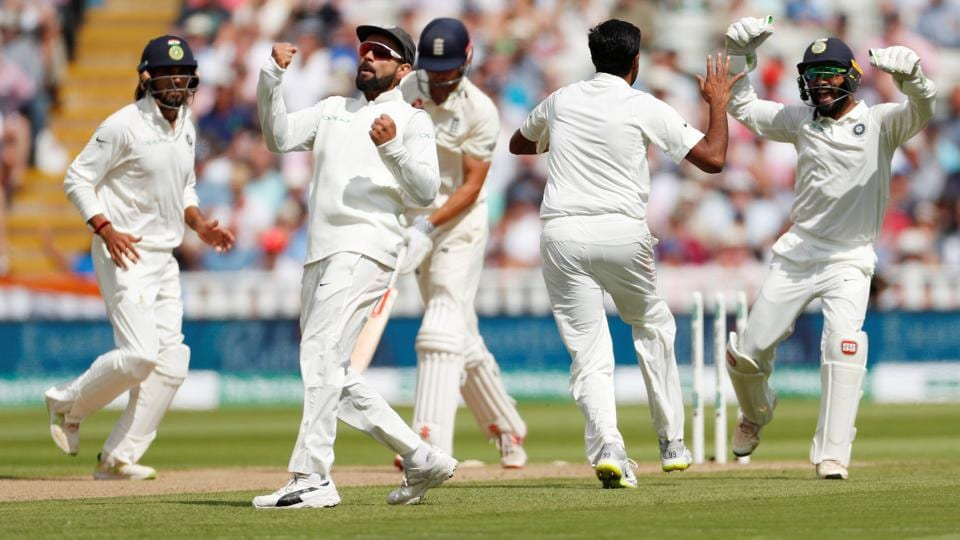 Virat Kohli celebrates after Ravichandran Ashwin bowled out England's Alastair Cook during the first day of the test match at Edgbaston, Birmingham on Wednesday. (Andrew Boyers / Reuters)