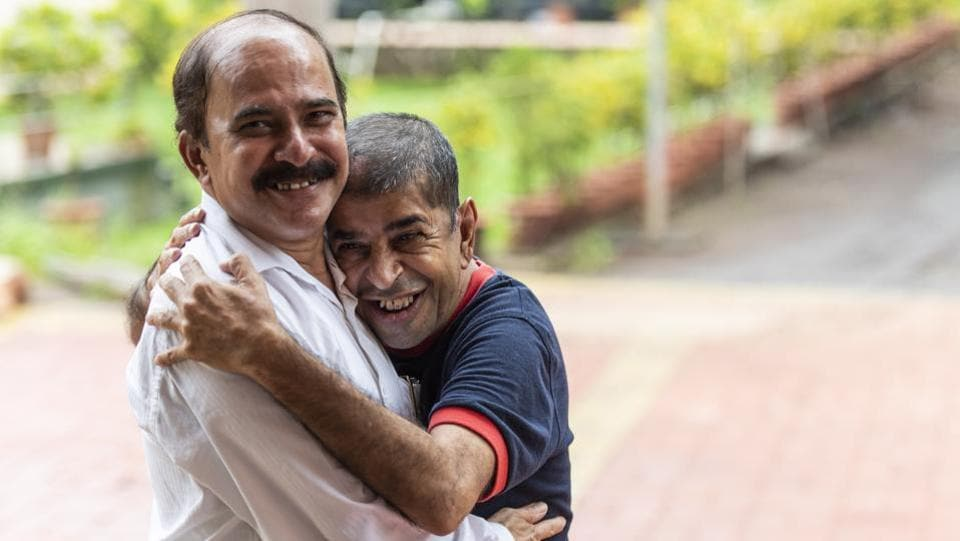 Vishwas Gore (L), 57, runs the 5-acre Adhar facility in Badlapur, set up in 1994 by a trust made up of parents. It houses 220 people aged 18 to 75. Dr Nimesh Desai, director of the Institute of Human Behaviour and Allied Sciences (IHBAS), Delhi says it's a welcome step for parents' associations to start such homes but the shift to semi-formal or formal models must adhere to some minimum standards set by the government. (Aalok Soni / HT Photo)