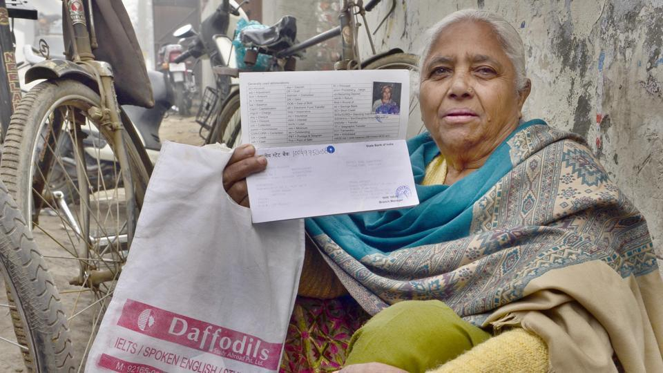 A woman waits outside a bank in Amritsar, Punjab. The gender disparities faced by women get exacerbated in old age since the woman often has no income or assets and is completely dependent on her family.