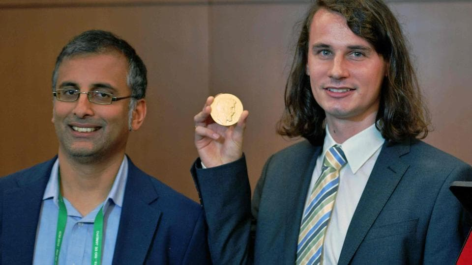 (Left to rright) Indian Australian mathematician, Akshay Venkatesh and German mathematician Peter Scholze, two of the four winners of mathematics' prestigious Fields medal, often known as the Nobel prize for math pose at the International Congress of Mathematicians in Rio de Janeiro, Brazil.