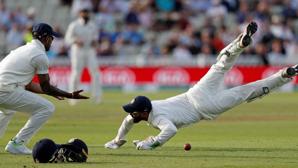 India's wicket keeper Dinesh Karthik (R) dives in front of 1st slip Shikhar Dhawan (L) in an attempt to catch England's Sam Curran on the first day of the first Test cricket match between England and India at Edgbaston. (AFP)