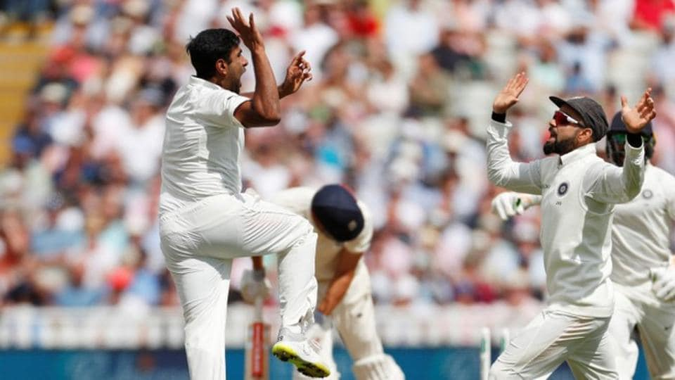 India's Ravichandran Ashwin celebrates with Virat Kohli after taking the wicket of England's Alastair Cook (Action Images via Reuters)
