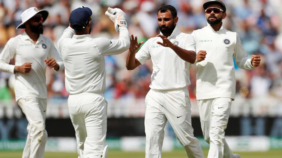 India's Mohammed Shami celebrates after taking the wicket of England's Dawid Malan. (Action Images via Reuters)