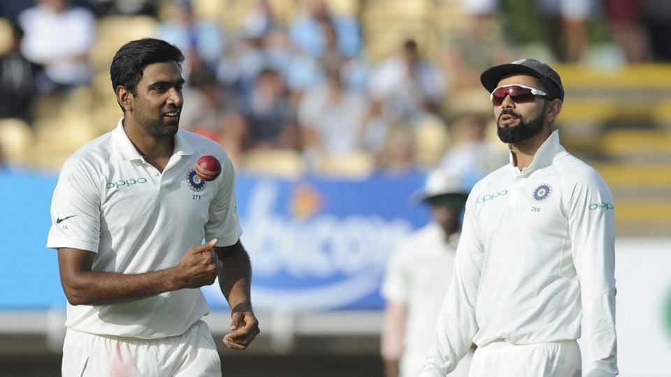 Indian cricket captain Virat Kohli, right, speaks to bowler Ravichandran Ashwin during the first day of the first test cricket match between England and India at Edgbaston.