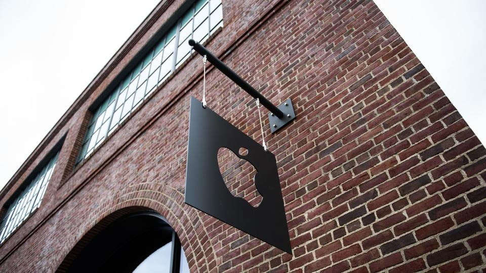 Apple Inc. signage hangs outside of the company's Williamsburg store in the Brooklyn borough of New York, US.