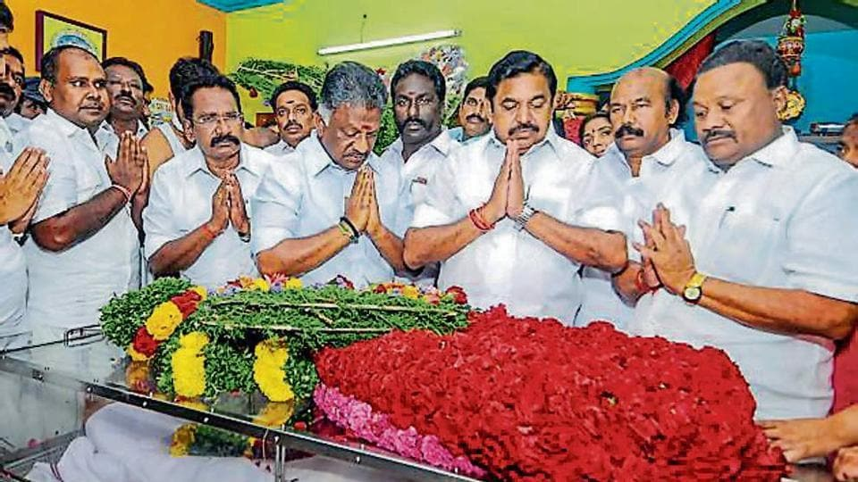 Tamil Nadu CM E Palaniswami and his deputy O Panneerselvam pay tributes to AIADMK MLA AK Bose, in Madurai on Thursday.