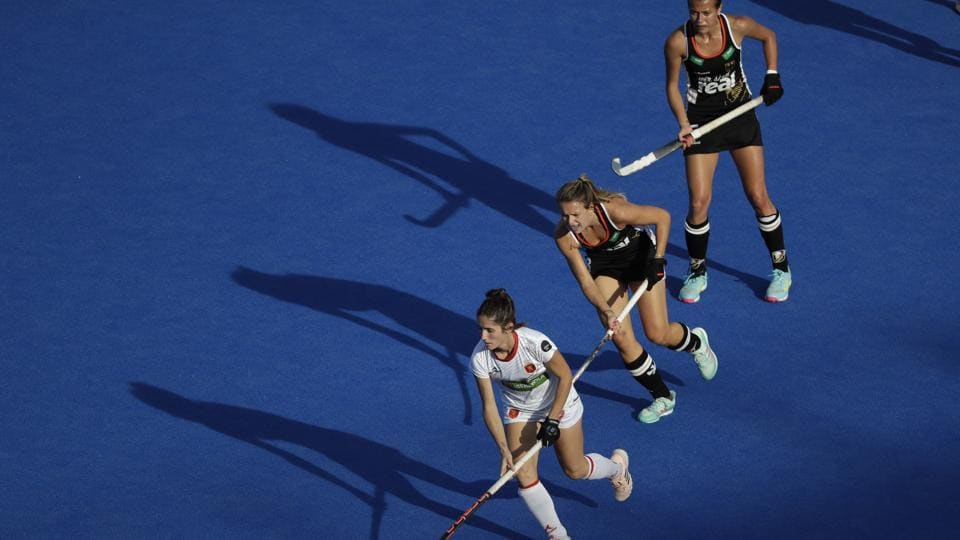 Spain's Carlota Petchame, (L), runs with the ball during the Women's Hockey World Cup quarterfinal match between Germany and Spain at the Lee Valley Hockey and Tennis Centre in London, England. (Matt Dunham / AP)