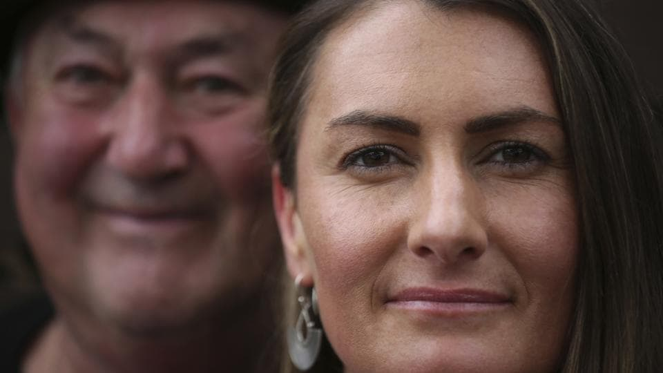 Peter Peacock (L), 68, and Gypsy Diamond, 36, pose for a portrait after an interview with The Associated Press, in Melbourne, Australia. Peacock, who donated sperm anonymously around 1980, was recently contacted by Diamond, his biological daughter, after a new law in Australia retroactively removed the anonymity granted to sperm donors decades ago. (Wong Maye-E / AP)