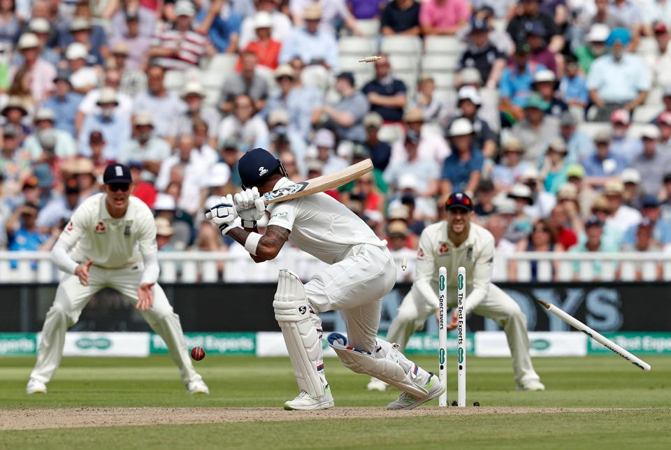 India's KL Rahul (C) is bowled by England's Sam Curran on the second day of the first Test cricket match between England and India at Edgbaston. (AFP)