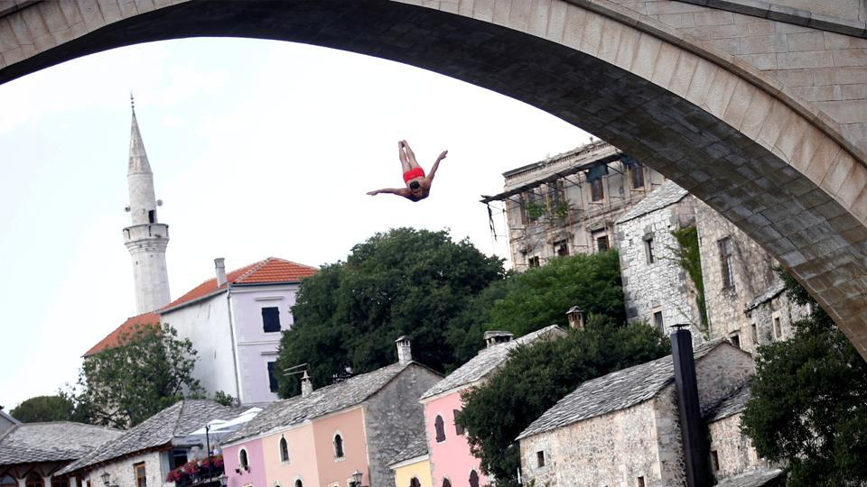 A man jumps from the Old Bridge during the 452nd traditional diving competition in Mostar, Bosnia and Herzegovina. (Dado Ruvic / REUTERS)