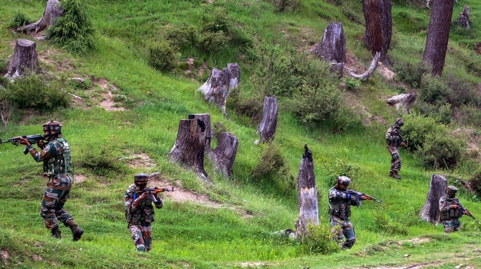 Two militants were gunned down after an encounter broke out with security forces on Friday in Jammu and Kashmir's Baramulla district, news agency ANI reported. Acting on specific information about presence of militants in Watergam area of Sopore, security forces launched a cordon and search operation there, a police official said. (Waseem Andrabi / HT File)