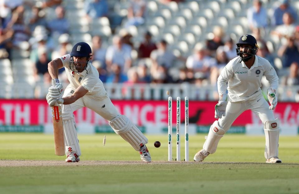 England's Alastair Cook is bowled out by India's Ravichandran Ashwin. (REUTERS)