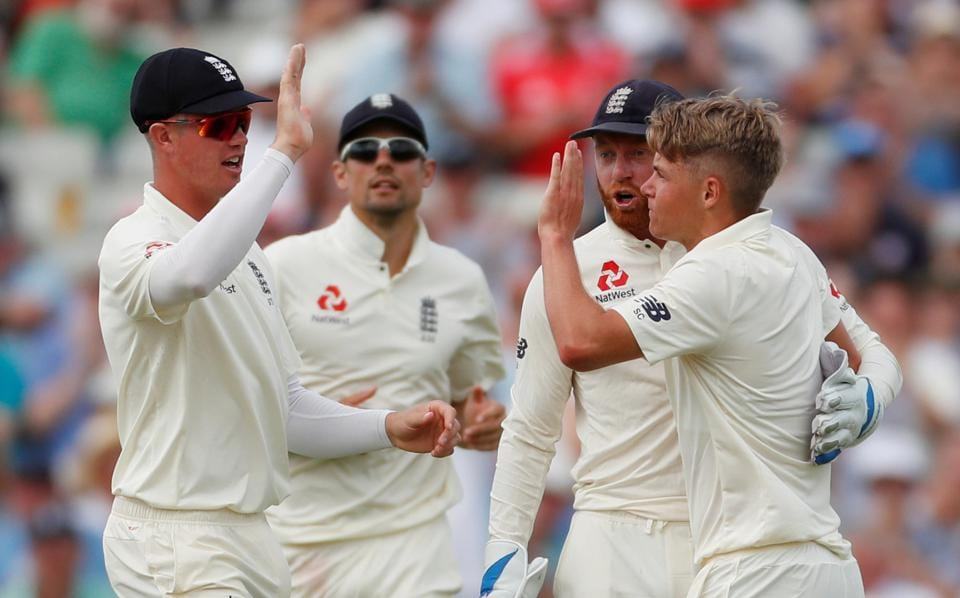 England's Sam Curran celebrates with team mates after taking the wicket of India's Hardik Pandya. (Action Images via Reuters)