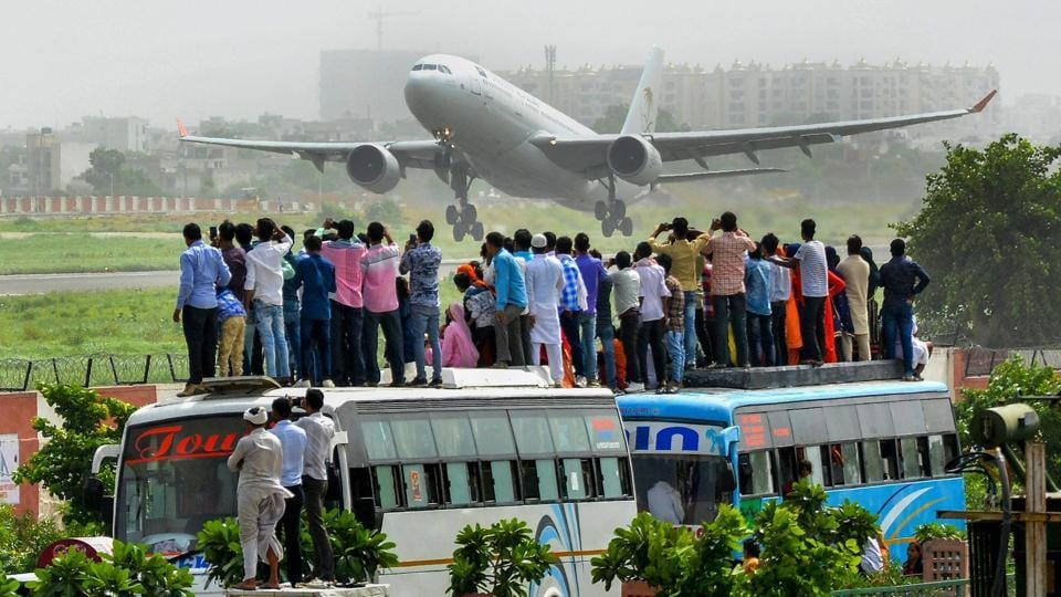 People look on as a flight carrying Haj pilgrims takes off, in Jaipur, Rajasthan on August  02, 2018. (PTI)