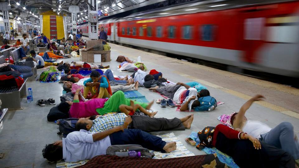 Candidates appearing for Uttar Pradesh state high school teachers examinations sleep on a platform after arriving at a railway station past midnight in Allahabad on July 29, 2018. (Rajesh Kumar Singh / AP)