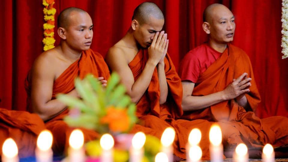 Buddhist monks pray during the 2606th 'Dhammacakka Pavattana' day celebrations at the Maha Bodhi Society in Bangalore, Karnataka on July 29, 2018. (Manjunath Kiran / AFP)