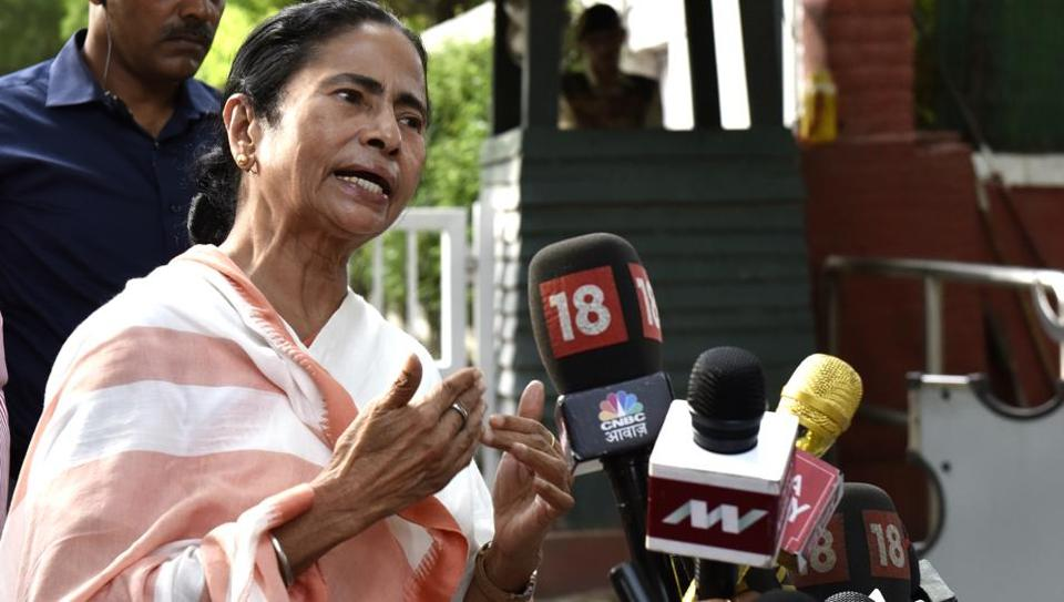 West Bengal chief minister Mamata Banerjee speaks to the media after attending a meeting with Congress leader Sonia Gandhi in New Delhi on Wednesday.